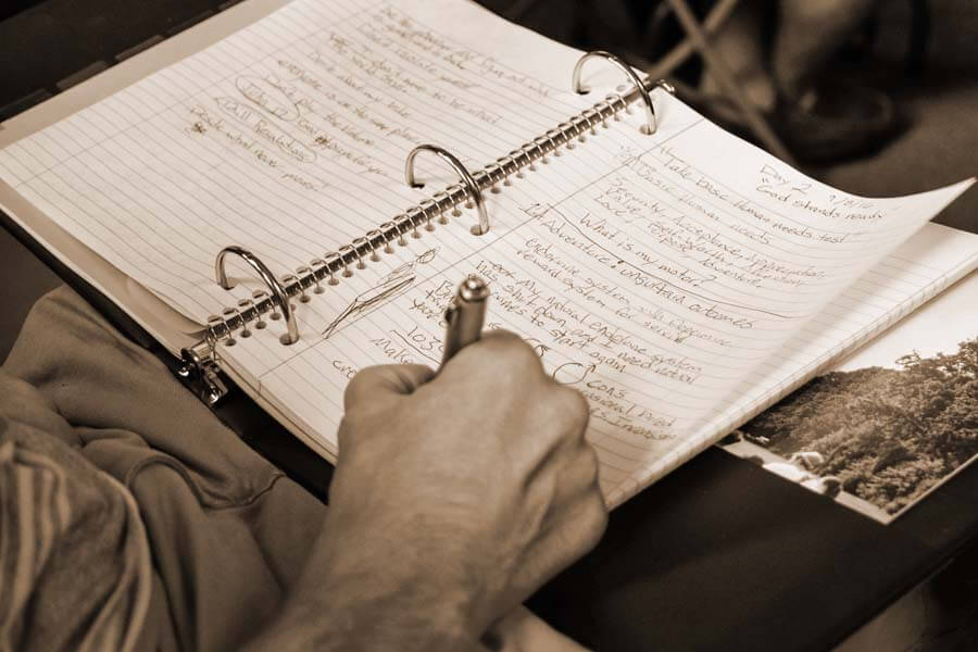 Man who attends a non profit rehab center in Tennessee writing about his journey in a journal